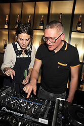 ALEXA CHUNG and GILES DEACON at the opening of the Atelier Moet pop-up boutique, 70 New Bond Street, London on 3rd December 2008.
