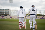 Michael Carberry and Kyle Abbott of Hampshire walk out to bat at the start of day 3 of the Specsavers County Champ Div 1 match between Hampshire County Cricket Club and Middlesex County Cricket Club at the Ageas Bowl, Southampton, United Kingdom on 16 April 2017. Photo by David Vokes.