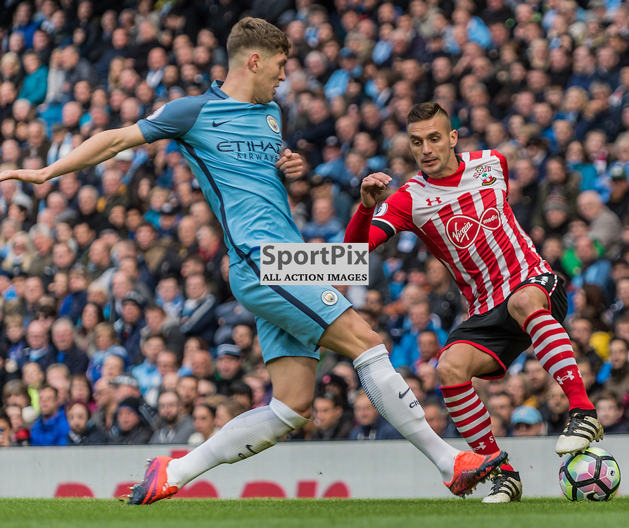 Southampton midfielder Dusan Tadic (11) on the ball marked by Manchester City defender John Stones (24) in the Premier League match between Manchester City and Southampton<br /> <br /> (c) John Baguley | SportPix.org.uk