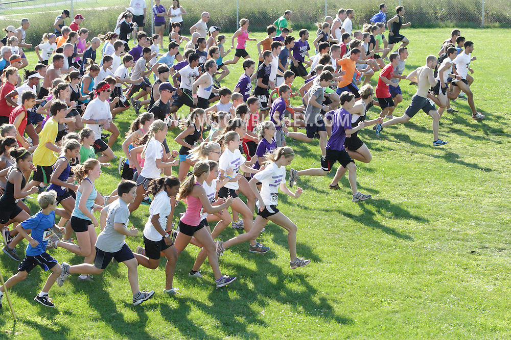 Central Valley, New York - Runners take off at the start of the Woodbury Country Ramble 5K race on Aug. 26, 2012.