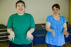 Two women Day Service users with learning disabilities enjoying a dance class,