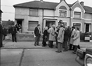"John O'Grady Rescued By Gardai.   (R67)..1987..05.11.1987..11.05.1987..5th November 1987..After being kidnapped from his home in Cabinteely, Co Dublin, John O'Grady was finally rescued after twenty one days in captivity. he was located in a house inCarnlough Road, Cabra West, Dublin. During his ordeal Mr O""Grady was mutilated by the kidnappers led by Dessie O'Hare to apply pressure on his family to pay the ransom sought. In an ensuing gun battle with the kidnappers a detective garda was shot and seriously wounded. In the chaos that followed the kidnappers escaped and were not all captured for a further three weeks after a massive manhunt...Image shows reporters surrounding one of the Gardai directly involved in the rescue of John O'Grady."