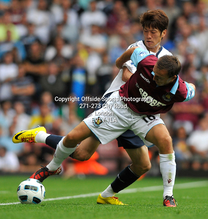 21/08/2010 - Premiership Football - West Ham United vs Bolton Wanderers - Mark Noble holds the ball up for West Ham. - Photo: Charlie Crowhurst / Offside.