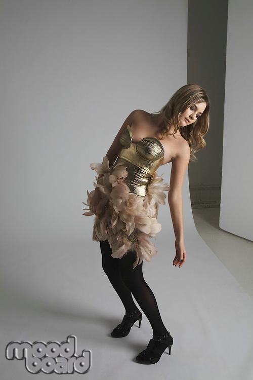 Full length of fashion model posing in studio