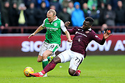 Esmael Goncalves (#77) of Heart of Midlothian slides in to win the ball from Dylan McGeouch (#10) of Hibernian during the William Hill Scottish Cup 4th round match between Heart of Midlothian and Hibernian at Tynecastle Stadium, Gorgie, Scotland on 21 January 2018. Photo by Craig Doyle.