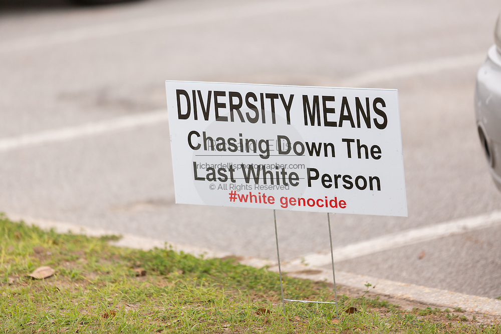 A racist sign along a road in North Charleston following a healing service at Charity Missionary Baptist Church April 12, 2015 in North Charleston, South Carolina. During the service Rev. Al Sharpton spoke following the recent fatal shooting of unarmed motorist Walter Scott police and thanked the Mayor and Police Chief for doing the right thing in charging the officer with murder.