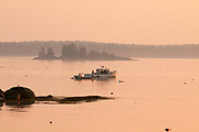 Lobster boat at sunrise in Spruce Head, Maine.