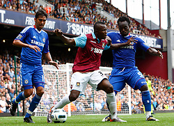 11.09.2010, Boleyn Ground Upton Park, London, ENG, PL, West Ham United vs FC Chelsea, im Bild Victor Obina of West Ham United on Loan from Internazionale Milano holds of Chelsea's Ghanaian footballer Michael Essien scores 1st Goal.  Barclays Premier League West Ham United v Chelsea.at Boleyn Ground Upton Park. EXPA Pictures © 2010, PhotoCredit: EXPA/ IPS/ Kieran Galvin +++++ ATTENTION - OUT OF ENGLAND/UK +++++ / SPORTIDA PHOTO AGENCY