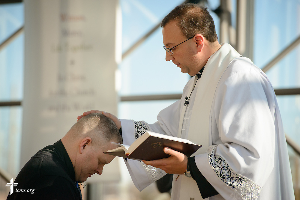 The Rev. Bart Day, executive director of Office of National Mission and new national missionary, the Rev. Peter M. Burfeind, pray during a Service of Sending for him and the Rev. Adam DeGroot at the International Center chapel of The Lutheran Church–Missouri Synod on Tuesday, Jan. 12, 2016, in Kirkwood, Mo. LCMS Communications/Erik M. Lunsford