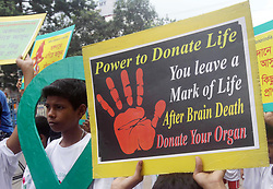 August 12, 2017 - Kolkata, West Bengal, India - Children hold the poster during the ''Organ Donation Day'' awareness rally and ''Walk for Life'' organised by CM Health Welfare Society on occasion of World Organ Donation Day August 13, 2017 in Kolkata. The Organ Donation Day observes annually to motivate to donate organ after death and to create awareness about the importance of organ donation. (Credit Image: © Saikat Paul/Pacific Press via ZUMA Wire)