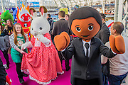 Playmobil characters on the parade - The London Toy Fair opens at Olympia exhibition centre. Organised by the British Toy and Hobby Association it is the only dedicated toy, game and hobby trade exhibition in the UK. It runs for three days, with more than 240 exhibiting companies ranging from the large internationals to the new start up companies.