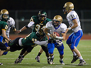 Wahlert's Riley McCarron (6) tries to pull away from Kennedy's David Hynek (52) during the first half of the game between Cedar Rapids Kennedy and Dubuque Wahlert at Kingston Stadium in Cedar Rapids on Friday night, October 21, 2011.