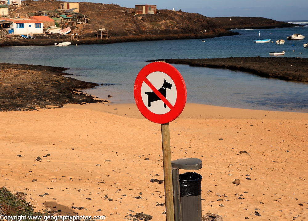 No dogs on beach sign village of Majanicho on the north coast, Fuerteventura, Canary Islands, Spain