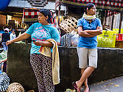 11 OCTOBER 2016 - UBUD, BALI, INDONESIA:  Women in the morning market in Ubud. The morning market in Ubud is for produce and meat and serves local people from about 4:30 AM until about 7:30 AM. As the morning progresses the local vendors pack up and leave and vendors selling tourist curios move in. By about 8:30 AM the market is mostly a tourist market selling curios to tourists. Ubud is Bali's art and cultural center.     PHOTO BY JACK KURTZ
