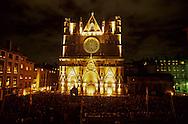 France. Lyon . Each year the fiesta of the light is held on December 8.     historical light show on Primatial Saint Jean       Chaque annee, le 8 decembre, jour de la fête des lumières. La primatiale St jean s'illumine, et les lyonnais se retrouvent  sur le parvis. Cette tradition est nee en 1852, avec l'inauguration de la statue de la vierge à Fourvière      R00063 9    L931208b     P0000261