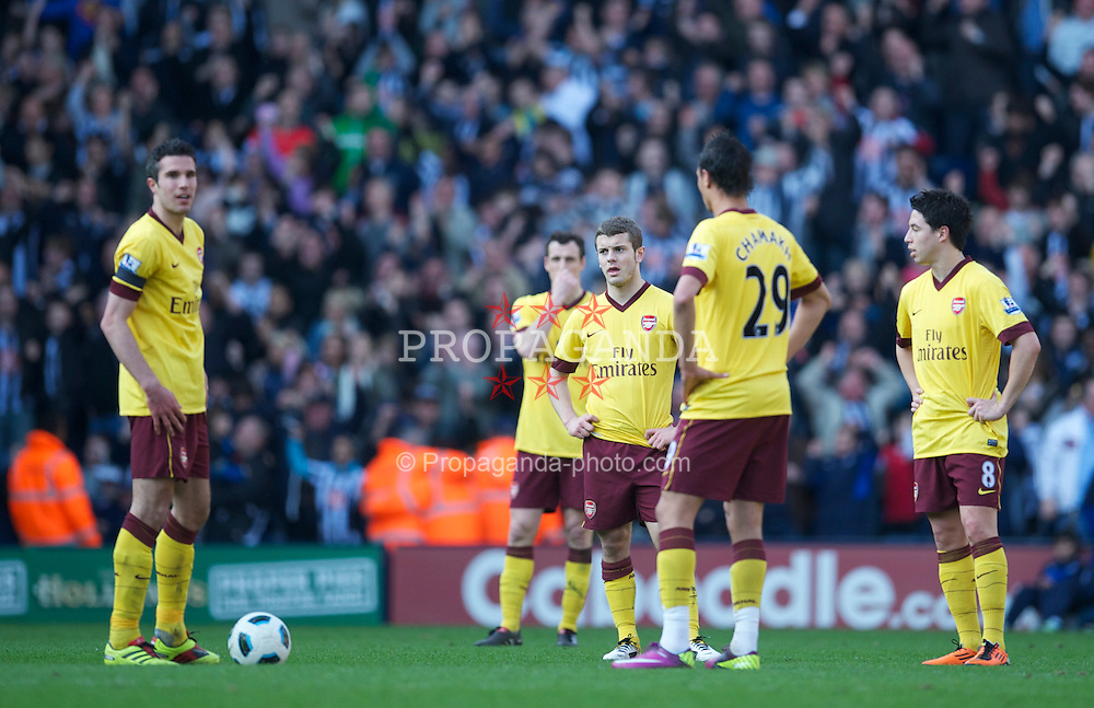WEST BROMWICH, ENGLAND - Saturday, March 19, 2011: Arsenal's Robin Van Persie and Jack Wiltshire look dejected as West Bromwich Albion score the second goal during the Premiership match at the Hawthorns. (Photo by David Rawcliffe/Propaganda)