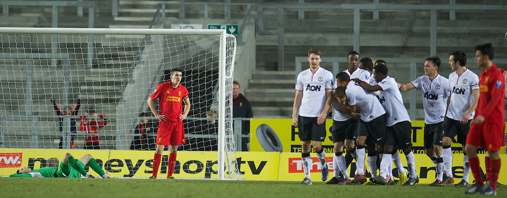 ST HELENS, ENGLAND - Monday, February 25, 2013: Liverpool's captain Conor Coady and goalkeeper Daniel Ward look dejected as Manchester United score a late winning goal during the Premier League Academy match at Langtree Park. (Pic by David Rawcliffe/Propaganda)