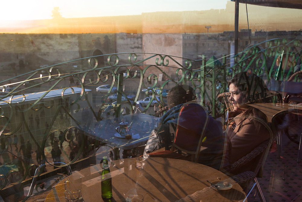 "Meknes, March 2015. A young couple discusses on the terrace of a cafe in Meknes. In the tradition of the Islamic countries, the concept of ""engagement"" exists only as a brief period before the marriage, in which the parties have already signed the agreement. In the majority of traditional families is very difficult that they accept a free relationship of two youths."