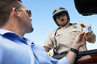 Man handing licence to police officer low angle view
