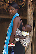 Ansarou Bald?, 17, and her one-year-old child in the village of Darou Hidjeratou on Tuesday June19, 2007.