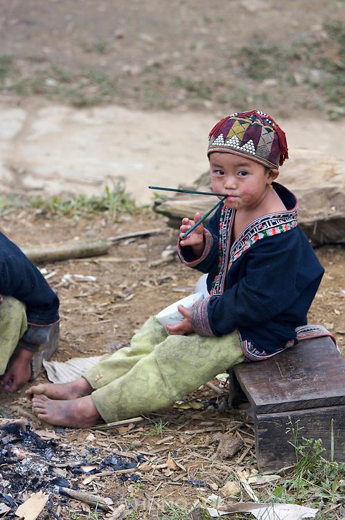 Hilltribe villages around Sapa. Red Dzao boy.