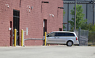A Dodge Caravan holding Russell Wasendorf Sr. enters the back of the United States Federal Court of the Northern District of Iowa in Cedar Rapids, Iowa, July 13, 2012.