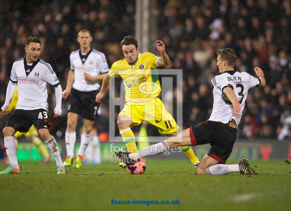 Picture by Alan Stanford/Focus Images Ltd +44 7915 056117<br /> 04/02/2014<br /> Dan Burn of Fulham tackles Jose Baxter of Sheffield United during the The FA Cup match at Craven Cottage, London