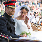 PIC BY GEOFF ROBINSON PHOTOGRAPHY 07976 880732.<br /> <br /> Picture dated May 19th 2018 shows Prince Harry and Meghan Markle greeting the crowds in Windsor on Kings Road after their wedding.<br /> <br />  Prince Harry and Meghan Markle have been declared husband and wife, following a ceremony at Windsor Castle.<br /> The couple exchanged vows and rings before the Queen and 600 guests at St George's Chapel.<br /> Wearing a dress by British designer Clare Waight Keller, Ms Markle was met by Prince Charles, who walked her down the aisle.<br /> Following their marriage, the couple will be known as the Duke and Duchess of Sussex.