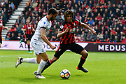 Andros Townsend (10) of Crystal Palace on the attack into the box with Nathan Ake (5) of AFC Bournemouth to get past during the Premier League match between Bournemouth and Crystal Palace at the Vitality Stadium, Bournemouth, England on 7 April 2018. Picture by Graham Hunt.
