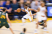 Golden State Warriors guard Ian Clark (21) pushes the ball down the court against the Utah Jazz at Oracle Arena in Oakland, Calif., on December 20, 2016. (Stan Olszewski/Special to S.F. Examiner)