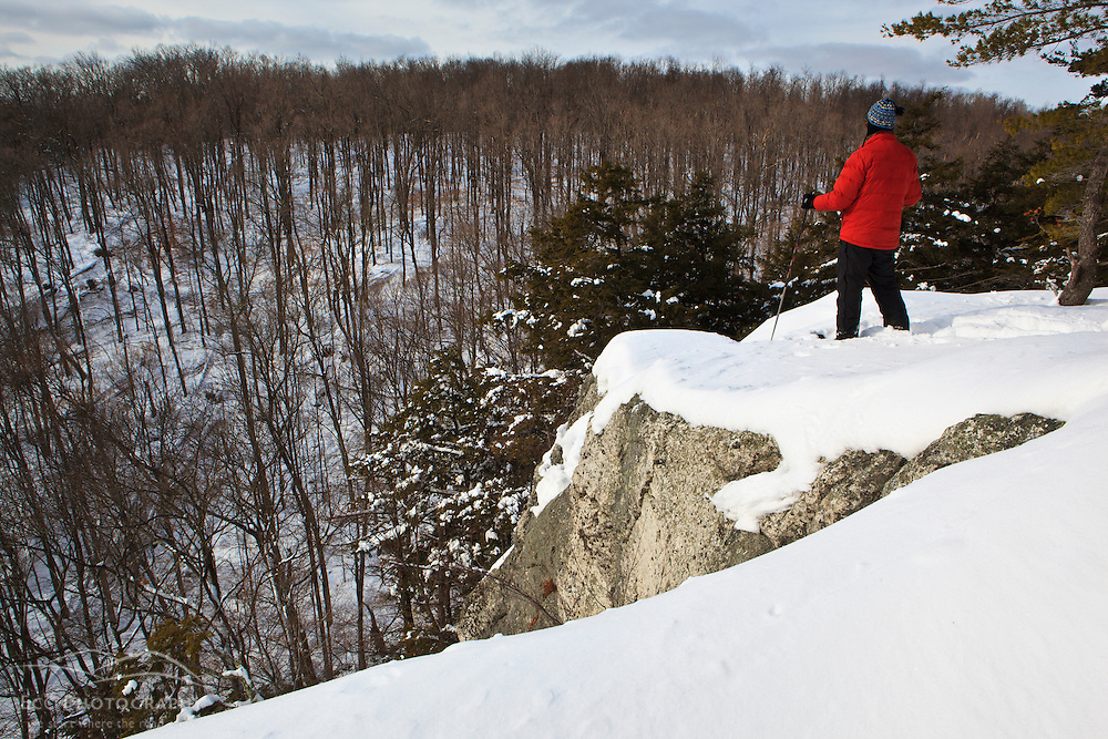 A man snowshoeing on Pony Mountain at the Chapel Brook Reservation in Ashfield, Massachusetts. The Trustees of Reservations.