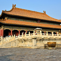 Palace of Heavenly Purity at Forbidden City in Beijing, China<br /> With a height over 65 feet, the largest structure within the Inner Court is the Palace of Heavenly Purity. It was modeled after but smaller than the more revered Hall of Supreme Harmony. Qianqing gong was the Emperor&rsquo;s living and sleeping quarters from 1420 until 1722. It was also common to have the emperor&rsquo;s remains lie in repose here for a couple of days prior to interment. Notice the huge gilded vats. There are 308 of them around the Forbidden City. Each contained 200 gallons of water. They were used to fight fires, a constant threat among the wooden buildings.