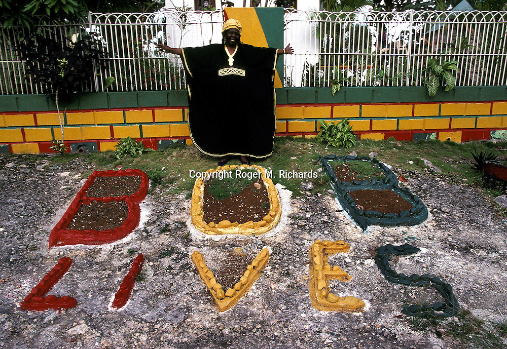Cedella Booker stands outside the compound housing the burial crypt of her son, the late Reggae superstar Bob Marley, July 1991, in the valley of Nine Miles in St. Ann, Jamaica. Bob Marley died of cancer in a Miami hospital at the age of 36 on May 11, 1981. (Photo by Roger M. Richards)