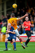 Steven Naismith (#14) of Heart of Midlothian holds Tom Aldred (#5) of Motherwell FC during the Ladbrokes Scottish Premiership match between Motherwell and Heart of Midlothian at Fir Park, Motherwell, Scotland on 15 September 2018.