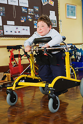Physically disabled child in a supportive seat,