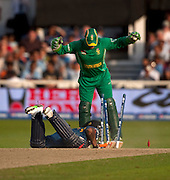 Suresh Raina in past wicket keeper Mark Boucher during the ICC World Twenty20 Cup match between South Africa and India at Trent Bridge. Photo © Graham Morris (Tel: +44(0)20 8969 4192 Email: sales@cricketpix.com)