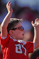 A young fan cheers on his Wolfpack during homecoming game.