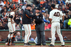 SAN FRANCISCO, CA - APRIL 09:  Bruce Bochy #15 of the San Francisco Giants and Buster Posey #28 argue with umpire Brian O'Nora #7 after Scott Van Slyke (not pictured) of the Los Angeles Dodgers was ruled hit by a pitch from Madison Bumgarner #40 scoring a run during the third inning at AT&T Park on April 9, 2016 in San Francisco, California.  (Photo by Jason O. Watson/Getty Images) *** Local Caption *** Bruce Bochy; Madison Bumgarner; Brian O'Nora; Buster Posey