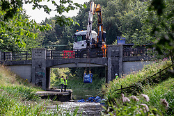 Pictured: Engineers work quickly to dam the Union Canal after a landslip burst the banks and began draining the canal close to Whitecross near Linlithgow during severe thunder and lightning storms that struck the central belt of Scotland overnight.   Andrew West/ EEm