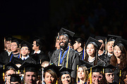 International Students stand for recognition during the fall 2014 commencement ceremony.