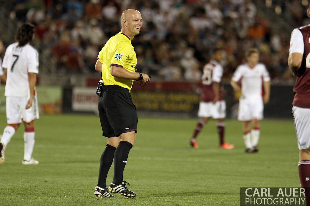 July 17th, 2013 - Referee Allen Chapman shares a laugh with a Colorado player in the second half of the Major League Soccer match between the New England Revolution and the Colorado Rapids at Dick's Sporting Goods Park in Commerce City, CO