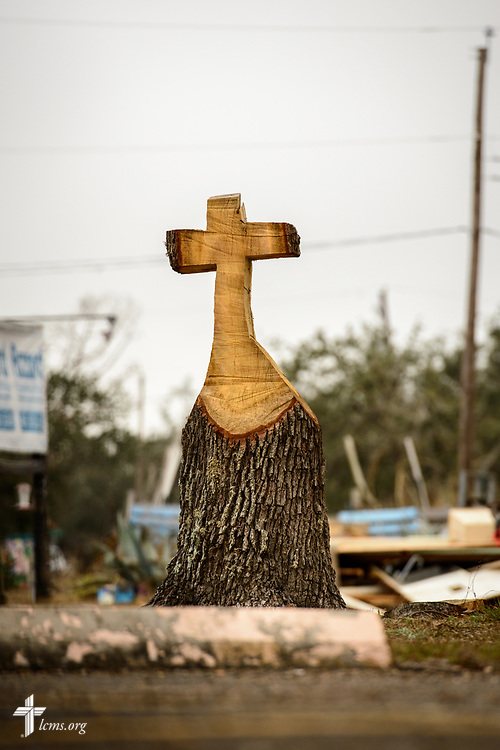 A cross cut into the stump of a damaged tree by members of a LERT team from St. Peter's Evangelical Lutheran Church, Hampshire, Ill., stands on the roadside outside of Peace Lutheran Church, Rockport, Texas, on Tuesday, Feb. 6, 2018. Recovery work is still underway almost six months after Hurricane Harvey devastated parts of Texas.  LCMS Communications/Erik M. Lunsford