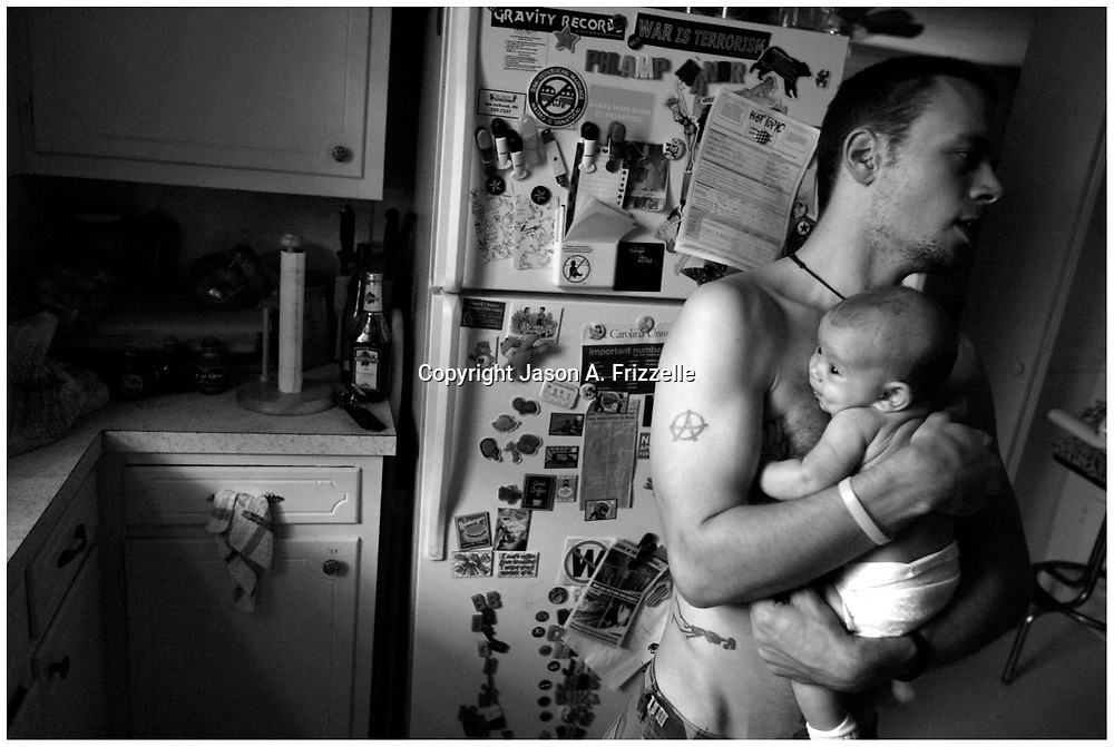 Gabe Albanese stands in the kitchen of the house with his daughter Jubilee. Jenn later moved out of the house because the couple agreed if they were gonna stay together they couldn't live together at this time.