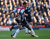 Photo: Rich Eaton.<br /> <br /> Aston Villa v West Ham. The Barclays Premiership. 03/02/2007. John Carew of Aston Villa at rear tries to get the better of Luis Boa Morte of West Ham