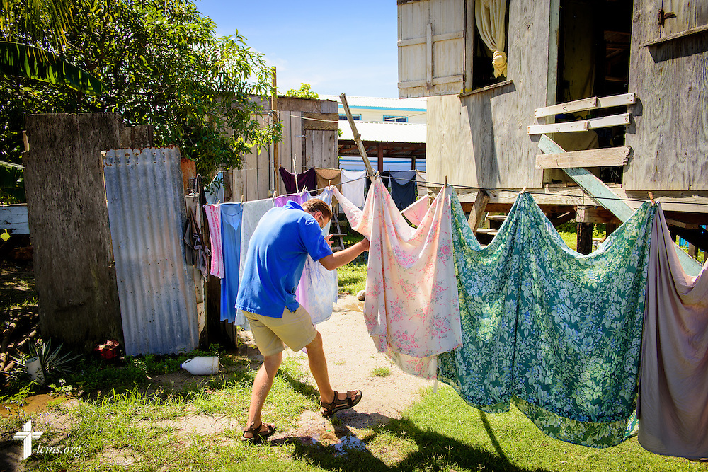 The Rev. Duane Meissner, career missionary to Belize, dodges laundry on the line as he visits a resident on Tuesday, Sept. 27, 2016, in the village of Seine Bight, Belize. Meissner's objective is to plant the first Lutheran churches in the country. LCMS Communications/Erik M. Lunsford