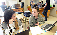 From left, Destini Rivera, 14 and Kayla Rowland, 14 chat as they work on a lab problem with a laptop during science class Friday, March 17, 2017 at Upper Perkiomen High School in Pennsburg, Pennsylvania. (WILLIAM THOMAS CAIN / For The Philadelphia Inquirer)