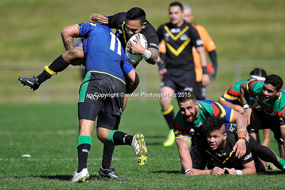 Michael Strickland of the Orcas is tackled by Terry Kopua of the Stallions during the NRL National Premiership rugby league match between Wellington Orcas v Wai-Coa-Bay Stallions at Porirua Park in Wellington on Saturday the 12th September 2015. Copyright photo by Marty Melville / www.photosport.nz