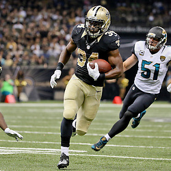 Dec 27, 2015; New Orleans, LA, USA; New Orleans Saints running back Tim Hightower (34) runs pastJacksonville Jaguars middle linebacker Paul Posluszny (51) during the second quarter of a game at the Mercedes-Benz Superdome. Mandatory Credit: Derick E. Hingle-USA TODAY Sports