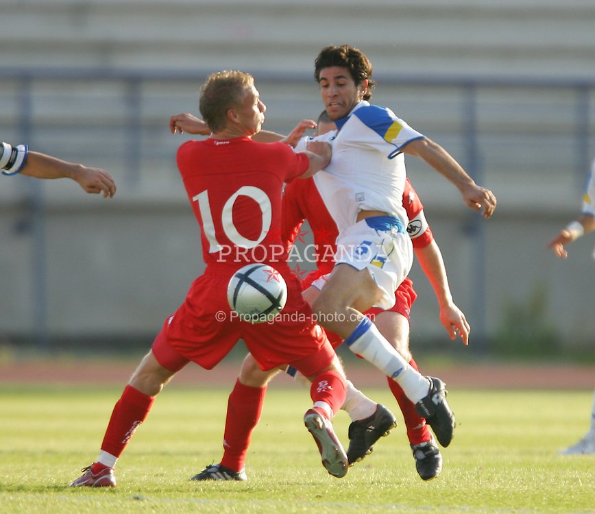PAPHOS, CYPRUS - TUESDAY, NOVEMBER 15th, 2005: Wales' David Cotterill and Cyprus' Georgios Pelagias during the Under-21 International Friendly match at the Paphiako Stadium. (Pic by David Rawcliffe/Propaganda)