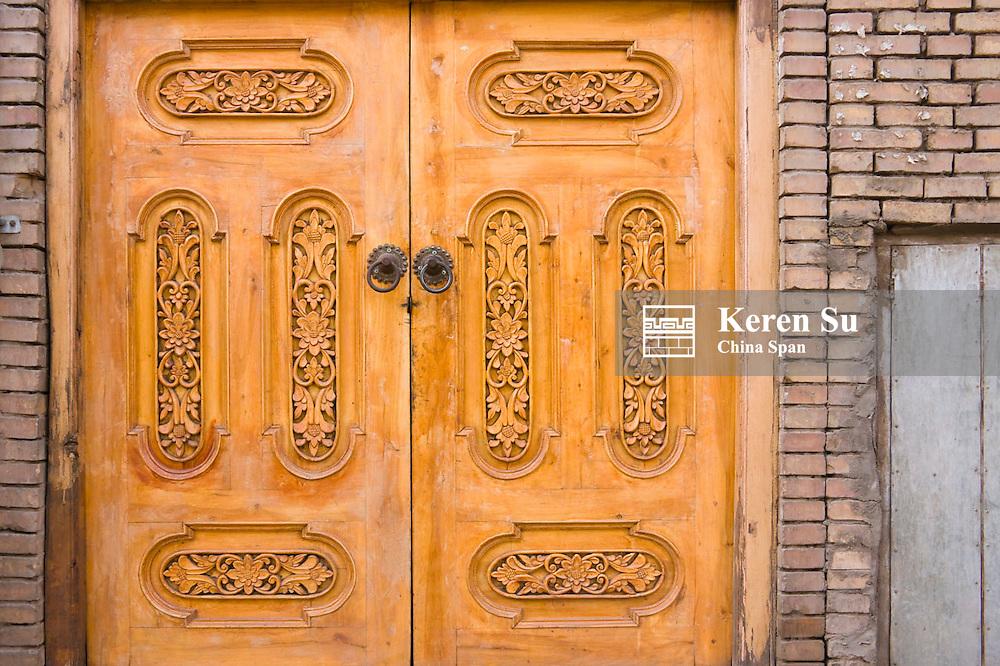 Traditional finely carved wood door, Kashgar, Xinjiang, China